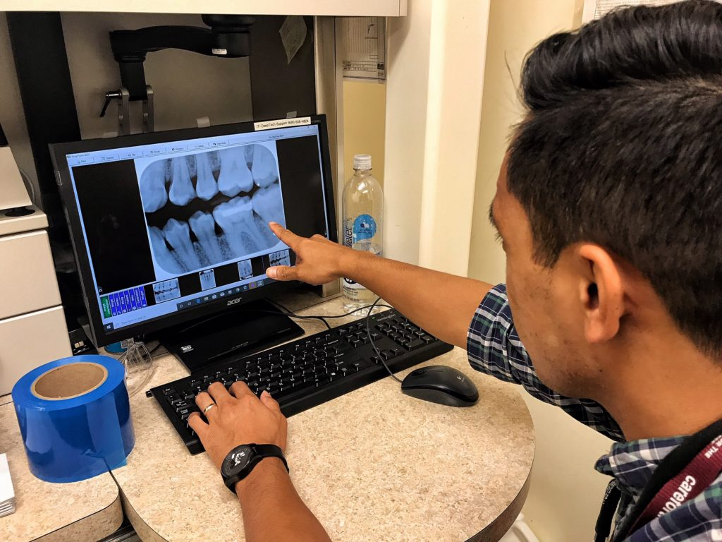 Dr. Makiling examining x-rays